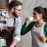 cheerful-loving-couple-bakers-drinking-coffee-PCAVA6B