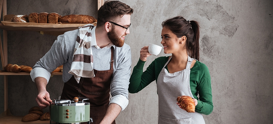 cheerful-loving-couple-bakers-drinking-coffee-PCAVA6B